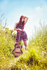 Romantic girl travelling with her guitar