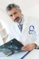 Doctor looking at X-ray results