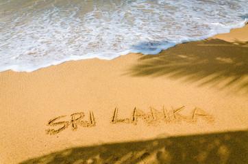 Sri Lanka written in a sandy on  tropical beach