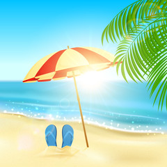 Flip flops and umbrella on the beach