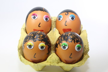 eggs decorated with eyes and hair