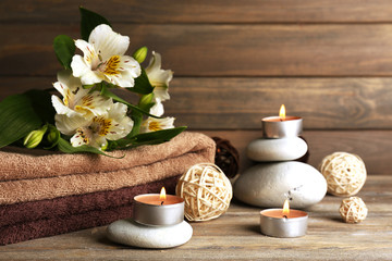 Beautiful spa composition with stones and flowers