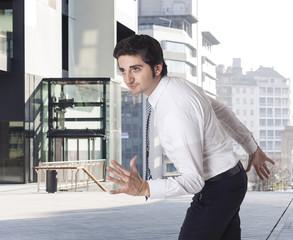 Determined businessman running and urban background