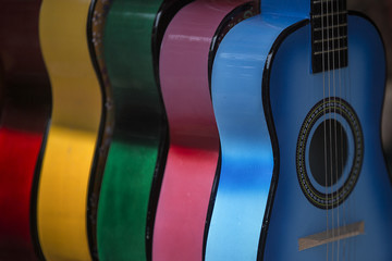 Multiple Colorful Acoustic Guitars