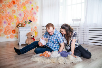parents and baby indoor