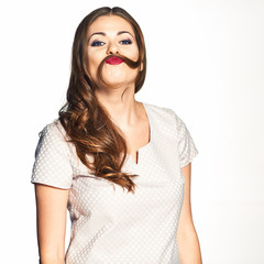 Portrait of beauty model with curl moustache under nose. Funny