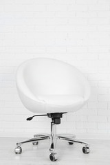 Armchair on white brick wall background