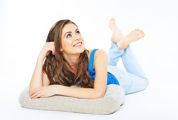 Smiling woman lying on a floor looking up.