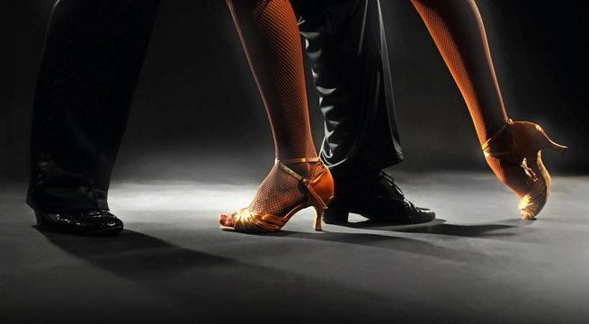 Feet partners on black background