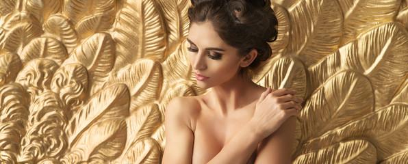 Half nude brunette cutie with large golden wings