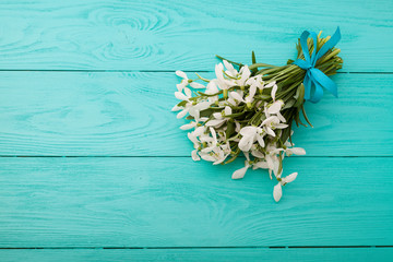 Bouquet of flowers on blue wooden background