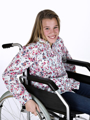 Girl in a wheelchair in hospital setting