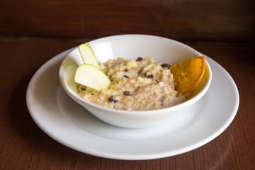 breakfast Oatmeal with apple, raisins, orange