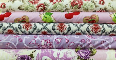 Rolls of colored fabrics