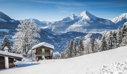 Idyllic winter landscape the Alps with mountain chalet