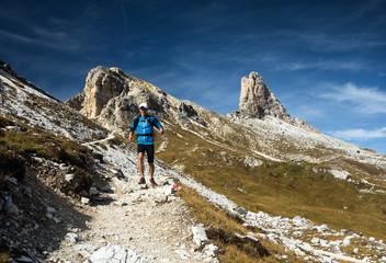 Man running downhill in Dolomites