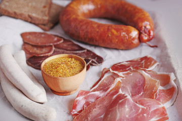 Assortment of deli meats on parchment background