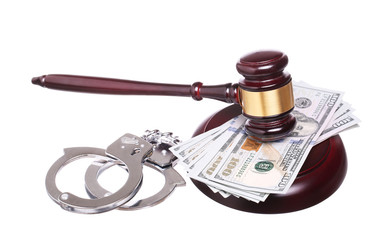 judge gavel and handcuffs with money isolated on white backgroun