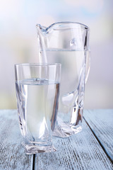 Glass pitcher and glass of water
