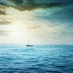 Small boat in the sea.