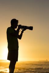 Photographer ready to photograph birds at sunset