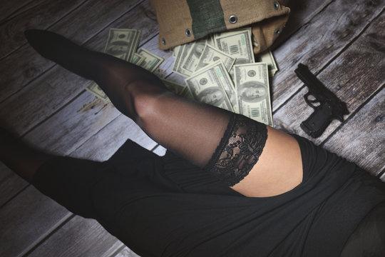 Woman in stockings and gun