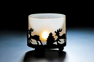 glass candle holder with a burning candle