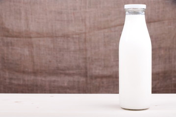 milk in a glass on the table side view