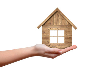 Wooden house in hand isolated on white background
