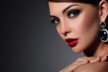 Portrait of beautiful young brunette woman in ear-rings