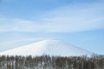 Main attraction of Moerenuma park, Mt. Moere, in Sapporo covered