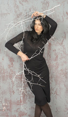 Girl in black dress with branches