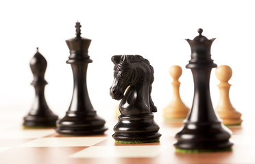 black chess pices on a chessboard