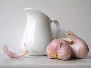 Still life with purple garlic and jug. Czech organic garlic.