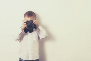 a little boy with a camera