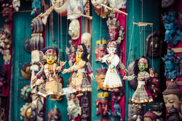 Masks, dolls and souvenirs in street shop at Durbar Square in Ka