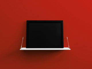Black blank picture frame on a white shelf red wall 3d render