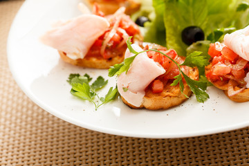 Bruschetta with tomato and ham
