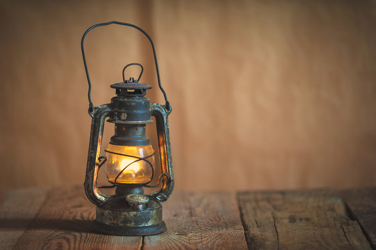 vintage kerosene oil lantern lamp burning with a soft glow light