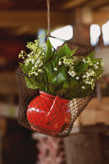 bouquet of lily of the valley in the old red jug - vintage