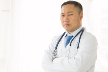 Asian male doctors at work