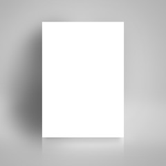 Blank White Poster Mock Up Leaning on White Studio Wall
