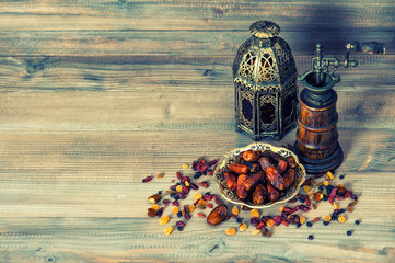 Raisins and dates. Vintage oriental lantern. Retro style toned