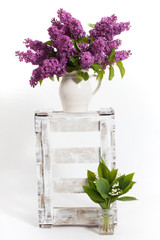 lilacs and lilies of the valley on a wooden crate - decoration