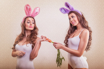 2 sexy bunny girl with bunny ears and carrot