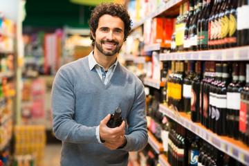 Man choosing a wine bottle