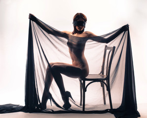Naked girl covered with transparent cloth