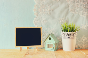 blackboard with room for text, vintage Flower pot and lantern as