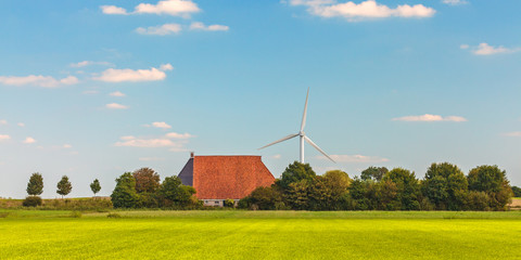 Panoramic image of a Dutch farm with wind turbines