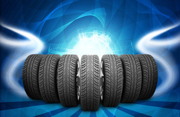 Wedge of new car wheels. Abstract background is lines and